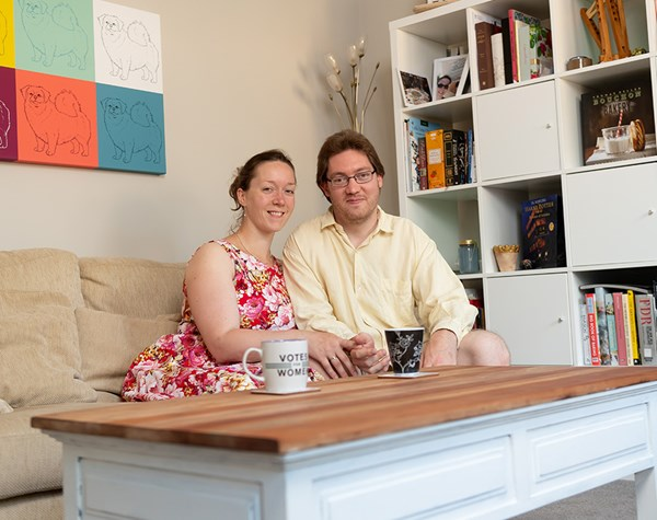 Couple sitting on a sofa in their new home